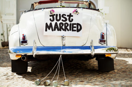 """Just Married"" Sign And Cans Attached To Car's Trunk"